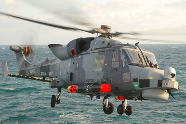 Royal Navy Wildcat helicopter lands on HMS Dragon